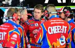 Carl Edwards, driver of the No. 99 Kellogg's Ford, speaks to crew members in the garage area - Photo Credit: Jason Smith/Getty Images for NASCAR