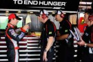 Jeff Gordon (far left), driver of the No. 24 Drive to End Hunger Chevrolet, talks with crew chief Alan Gustafson (second left) while crew members listen - Photo Credit: Jason Smith/Getty Images for NASCAR