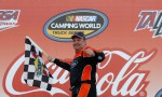 Mike Wallace celebrates winning the Coca-Cola 250 at Talladega Superspeedway, his fifth career NASCAR Camping World Truck Series victory. - Photo Credit: Chris Graythen/Getty Images