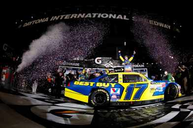 Matt Kenseth emerges from his car to celebrate his Daytona 500 victory at Daytona International Speedway. - Photo Credit: Todd Warshaw/Getty Images for NASCAR