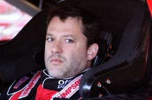 Tony Stewart looks on from his car in the garage area - Photo Credit: Christian Petersen/Getty Images