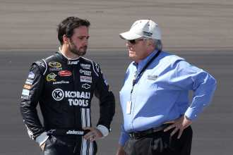 Five-time NASCAR Sprint Cup Series champion Jimmie Johnson talks with owner Rick Hendrick - Photo Credit: Christian Petersen/Getty Images