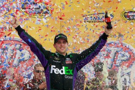 Denny Hamlin celebrates his 19th career NASCAR Sprint Cup Series win in Kansas Speedway's Victory Lane on Sunday in Kansas City, Kan. - Photo Credit: Chris Graythen/Getty Images for NASCAR