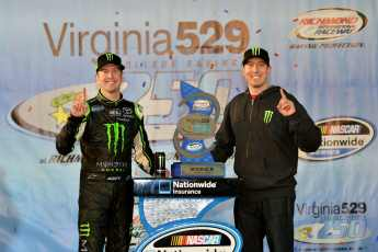 Kurt Busch (L), driver of the No. 54 Monster Energy Toyota, poses with his brother and team owner Kyle Busch (R) after winning the NASCAR Nationwide Series Virginia 529 College Savings 250 at Richmond International Raceway on Friday in Richmond, Va. - Photo Credit: Drew Hallowell/Getty Images for NASCAR