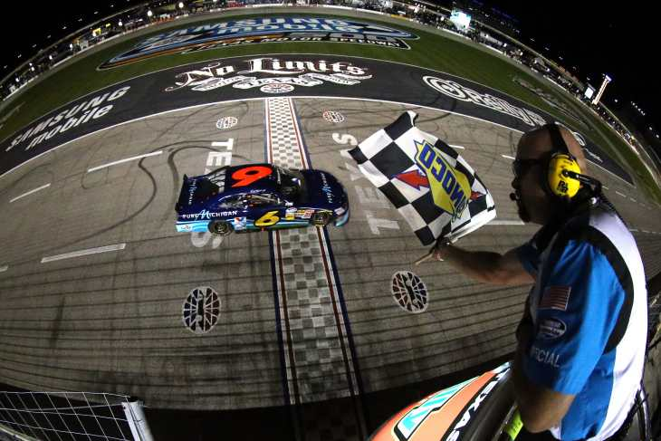 Ricky Stenhouse Jr., driver of the #6 Pure Michigan Ford, takes the checkered flag as he crosses the finish line to win the NASCAR Nationwide Series O'Reilly Auto Parts 300 at Texas Motor Speedway on April 13, 2012 in Fort Worth, Texas - Photo Credit: Chris Graythen/Getty Images for NASCAR