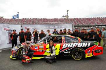 Jeff Gordon, driver of the #24 DuPont 20 Years Chevrolet, poses with the Coors Light Pole Award and Miss Coors Light Rachel Rupert after qualifying for pole position for the NASCAR Sprint Cup Series Aaron's 499 at Talladega Superspeedway on May 5, 2012 in Talladega, Alabama. - Photo Credit: Tom Pennington/Getty Images for NASCAR