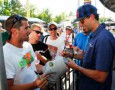 Sporting a New Haircut, Travis Pastrana Signs Autographs at Darlington - Photo Credit: Geoff Burke, Getty Images for NASCAR