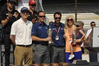 Susie Wheldon is presented with the Baby Borg -- Photo by: Jim Haines for IMS