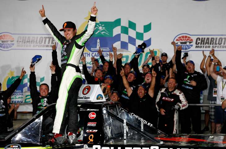 Justin Lofton, driver of the #6 CollegeComplete.com Chevrolet, celebrates in victory lane after winning the NASCAR Camping World Truck Series N.C. Education Lottery 200 at Charlotte Motor Speedway on May 18, 2012 in Charlotte, North Carolina. (Photo by Jeff Zelevansky/Getty Images for NASCAR)
