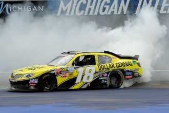 Joey Logano, driver of the No. 18 Dollar General Toyota, celebrates his win with a burnout after the NASCAR Nationwide Series Alliance Truck Parts 250 at Michigan International Speedway on Saturday in Brooklyn, Mich. - Photo Credit: John Harrelson/Getty Images for NASCAR
