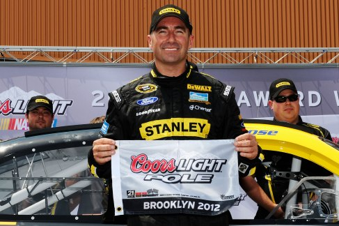Marcos Ambrose, driver of the No. 9 Stanley Ford, poses with the Coors Light Pole award after qualifying for pole position for the NASCAR Sprint Cup Series Quicken Loans 400 at Michigan International Speedway on Saturday in Brooklyn, Mich. - Photo Credit: Jared C. Tilton/Getty Images for NASCAR