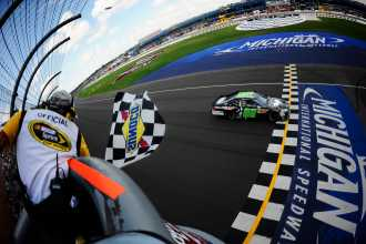 Dale Earnhardt Jr., driver of the No. 88 Diet Mountain Dew/TheDarkKnightRises/National Guard/ Chevrolet, crosses the finishline to win the NASCAR Sprint Cup Series Quicken Loans 400 at Michigan International Speedway on Sunday in Brooklyn, Mich - Photo Credit: Jared C. Tilton/Getty Images for NASCAR