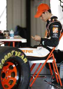 Joey Logano Tweeting - Photo Credit: Jeff Zelevansky/Getty Images for NASCAR