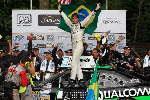 Nelson Piquet Jr. celebrates with his team in Victory Lane after winning the NASCAR Nationwide Series Sargento 200 at Road America on June 23 in Elkhart Lake, Wisc. - Photo Credit: Tyler Barrick/Getty Images for NASCAR