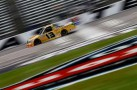 Johnny Sauter, driver of the No. 13 Hot Honeys/Curb Records Toyota, practices for the NASCAR Camping World Series WinStar World Casino 400 at Texas Motor Speedway on Thursday in Fort Worth, Texas. - Photo Credit: Tom Pennington/Getty Images for NASCAR