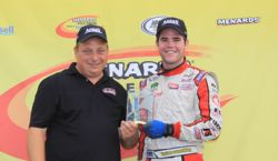 CGH Motorsports crew chief Kevin Reed (L) celebrates his first Menards pole qualifying presented by Ansell award with driver Chad Hackenbracht, driver of the No. 58 Tastee Apple Impala SS in the ARCA Racing Series presented by Menards for CGH Motorsports. (Photo Credit: Automobile Racing Club of America).
