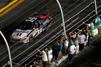 Tony Stewart, driver of the No. 14 Mobil 1/Office Depot Chevrolet, celebrates on track and salutes the fans after winning the NASCAR Sprint Cup Series Coke Zero 400 Powered by Coca-Cola at Daytona International Speedway on Saturday in Daytona Beach, Fla. - Photo Credit: Todd Warshaw/Getty Images for NASCAR