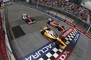 Ryan Hunter-Reay takes the checkered flag ahead of Charlie Kimball and Mike Conway at Honda Indy Toronto - Photo Credit: INDYCAR/LAT USA