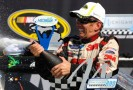Greg Biffle celebrates his Pure Michigan 400 win at Michigan International Speedway. - Photo Credit: Jared C. Tilton/Getty Images for NASCAR