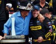 Team owner Richard Petty hugs Marcos Ambrose after the Australian driver&#039;s second straight Watkins Glen (N.Y.) International victory in the NASCAR Sprint Cup Series. - Photo Credit: Jeff Zelevansky, Getty Images for NASCAR
