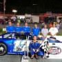 Ryan Wilson, driver of the No. 12 Southern Pharmacy Services / Randolph Bank Toyota Camry celebrates in victory lane with members of his Ryan Wilson Motorsports (RWM) in the NASCAR Whelen All American Series (NWAAS) event at Caraway (N.C.) Speedway.