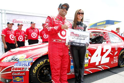 Juan Pablo Montoya, driver of the #42 Target Chevrolet, poses with the Coors Light Pole Award and Miss Coors Light Rachel Rupert after qualifying for the pole position for the NASCAR Sprint Cup Series Pennslyvania 400 at Pocono Raceway on August 4, 2012 in Long Pond, Pennsylvania. (Photo by Jeff Zelevansky/Getty Images)