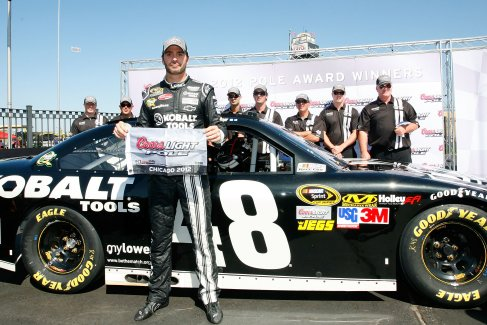 Jimmie Johnson, driver of the #48 Lowe&#039;s Kobalt Tools Chevrolet, poses with his pole award after he was the fastest driver during qualifying for the NASCAR Sprint Cup Series GEICO 400 at Chicagoland Speedway on September 15, 2012 in Joliet, Illinois. - Photo Credit: Tyler Barrick/Getty Images