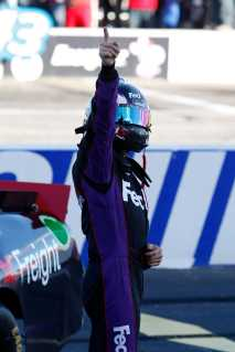 Denny Hamlin, driver of the #11 FedEx Freight Toyota, celebrates after winning the NASCAR Sprint Cup Series SYLVANIA 300 at New Hampshire Motor Speedway on September 23, 2012 in Loudon, New Hampshire. (Photo by Todd Warshaw/Getty Images for NASCAR)