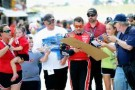 Tony Stewart signs autographs for the fans - Photo Credit: John Harrelson/Getty Images for NASCAR