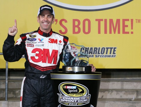Greg Biffle, driver of the #16 3M/IDG Ford, poses with the pole award trophy after qualifying for pole position for the NASCAR Sprint Cup Series Bank of America 500 - Photo Credit: Streeter Lecka/Getty Images for NASCAR