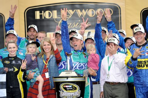 Matt Kenseth, driver of the #17 Zest Ford, celebrates with his wife Katie and their family in Victory Lane after winning the NASCAR Sprint Cup Series Hollywood Casino 400 at Kansas Speedway on October 21, 2012 in Kansas City, Kansas. - Photo Credit: John Harrelson/Getty Images for NASCAR