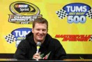 Dale Earnhardt Jr., driver of the #88 Diet Mountain Dew/National Guard/AMP Energy Chevrolet, speaks to the media prior to practice for the NASCAR Sprint Cup Series Tums Fast Relief 500 at Martinsville Speedway on October 26, 2012 in Ridgeway, Virginia. Earnhardt has been cleared to race after taking two races off while suffering symptoms from a concussion in Talladega. - Photo Credit: Streeter Lecka/Getty Images