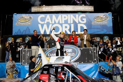 James Buescher, driver of the #31 Great Clips Chevrolet, celebrates in Champions Victory Lane after winning the Series Championship and finishing in thirteenth place in the NASCAR Camping World Truck Series Ford EcoBoost 200 at Homestead-Miami Speedway on November 16, 2012 in Homestead, Florida. - Photo Credit: Chris Graythen/Getty Images for NASCAR