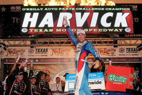 Kevin Harvick, driver of the #33 OneMain Financial Chevrolet, celebrates in Victory Lane after winning the NASCAR Nationwide Series O'Reilly Auto Parts Challenge at Texas Motor Speedway on November 3, 2012 in Fort Worth, Texas. - Photo Credit: Tom Pennington/Getty Images