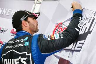 Jimmie Johnson Signing Coors Light Pole Award Board - Photo Credit: Tyler Barrick/Getty Images