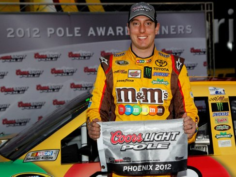 Kyle Busch, driver of the #18 M&M's Toyota, poses after qualifying for the pole position in the NASCAR Sprint Cup Series AdvoCare 500 at Phoenix International Raceway on November 9, 2012 in Avondale, Arizona. - Photo Credit: Tom Pennington/Getty Images