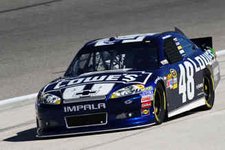 Jimmie Johnson in the No 48 Lowe's Chevy on the apron at Texas - Photo Credit: Todd Warshaw/Getty Images