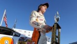 Tyler Reddick, driver of the #98 Broken Bow Dodge, stands with the trophy after winning the NASCAR K&N Pro Series East Classic 3 Championship at Rockingham Speedway on November 3, 2012 in Rockingham, North Carolina. (Photo by Streeter Lecka / Getty Images for NASCAR)