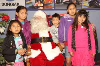 Nearly 250 Children Attend Race to the Holidays Christmas Party at Sonoma Raceway - Photo Credit: Joe Jacobson