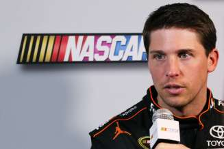 Driver Denny Hamlin speaks to the media during 2013 NASCAR media day at Daytona International Speedway on February 14, 2013 in Daytona Beach, Florida. - Photo Credit: Jonathan Ferrey/Getty Images