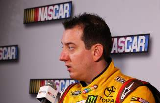 Driver Kyle Busch speaks to the media during 2013 NASCAR media day at Daytona International Speedway on February 14, 2013 in Daytona Beach, Florida. - Photo Credit: Jonathan Ferrey/Getty Images