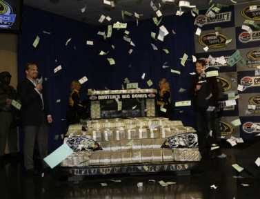 Marcus Smith and Brad Keselowski unveil a car made out of $1 million to announce Bruton's Big Bonus for the NASCAR Sprint All-Star Race. (Credit HHP/CMS)