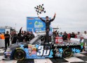 Kyle Larson, driver of the #30 Autism Speaks Chevrolet, celebrates after winning the NASCAR Camping World Truck Series Carolina 200 at Rockingham Speedway on April 14, 2013 in Rockingham, North Carolina. - Photo Credit: Streeter Lecka/Getty Images