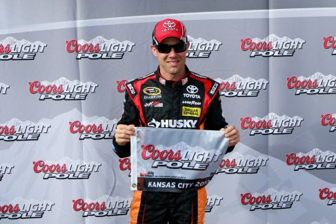 Matt Kenseth, driver of the #20 The Home Depot/Husky Toyota, poses with the Coors Light Pole award after qualifying for pole position for the NASCAR Sprint Cup Series STP 400 at Kansas Speedway on April 19, 2013 in Kansas City, Kansas. - Photo Credit: Chris Trotman/Getty Images