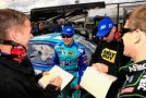 Ricky Stenhouse Jr., driver of the #17 Zest Ford, and Carl Edwards, driver of the #99 Aflac Ford, stands on the grid during qualifying for the NASCAR Sprint Cup Series STP 400 at Kansas Speedway on April 19, 2013 in Kansas City, Kansas. - Photo Credit: Jamie Squire/Getty Images