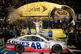 Jimmie Johnson, driver of the #48 Lowe's Patriotic Chevrolet, celebrates in Victory Lane after winning the NASCAR Sprint Cup Series All-Star race at Charlotte Motor Speedway on May 18, 2013 in Concord, North Carolina. - Photo Credit: Jerry Markland/Getty Images