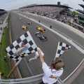 Tony Kanaan takes the 2013 IICS Indy 500 Checkered Flags for his first Brickyard victory- Photo Credit: Walter Kuhn for IMS