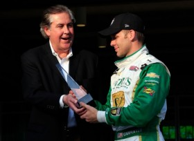 Indianapolis Motor Speedway and IndyCar CEO Jeff Belskus presents pole-winner Ed Carpenter, driver of the #20 Fuzzy's Vodka/Ed Carpenter Racing Chevrolet, with the trophy after qualifying for the 2013 Indianapolis 500 at Indianapolis Motor Speedway on May 18, 2013 in Indianapolis, Indiana. - Photo Credit: Jamie Squire/Getty Images