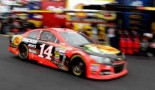 Tony Stewart, driver of the #14 Bass Pro Shops Chevrolet, drives through the garage - Photo Credit: Jerry Markland/Getty Images