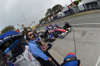 Larry Foyt watches 2013 IICS AJ Foyt Racing Driver Takuma Sato from the pits - Photo Credit: INDYCAR
